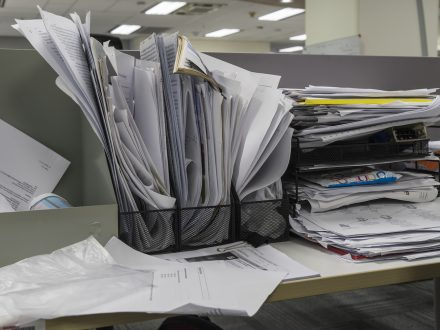 many documents on office desk: messy desk