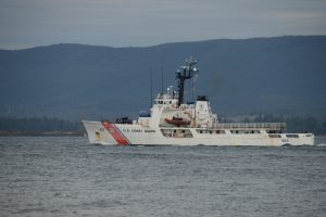 A white Coast Guard cutter on the Columbia River
