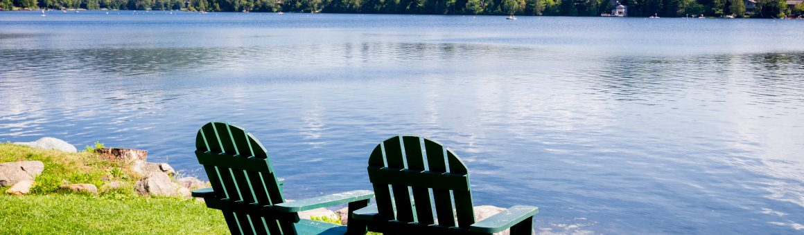 two chairs overlook a quiet lake encouraging government program managers to take a strategy offsite.