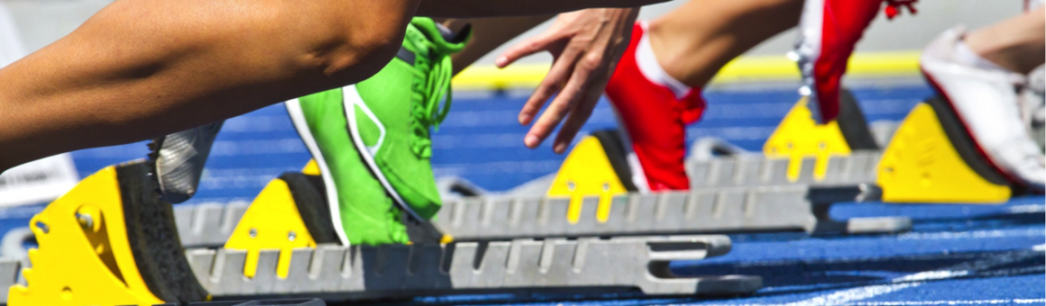 runners on starting blocks at a track to represent government performance