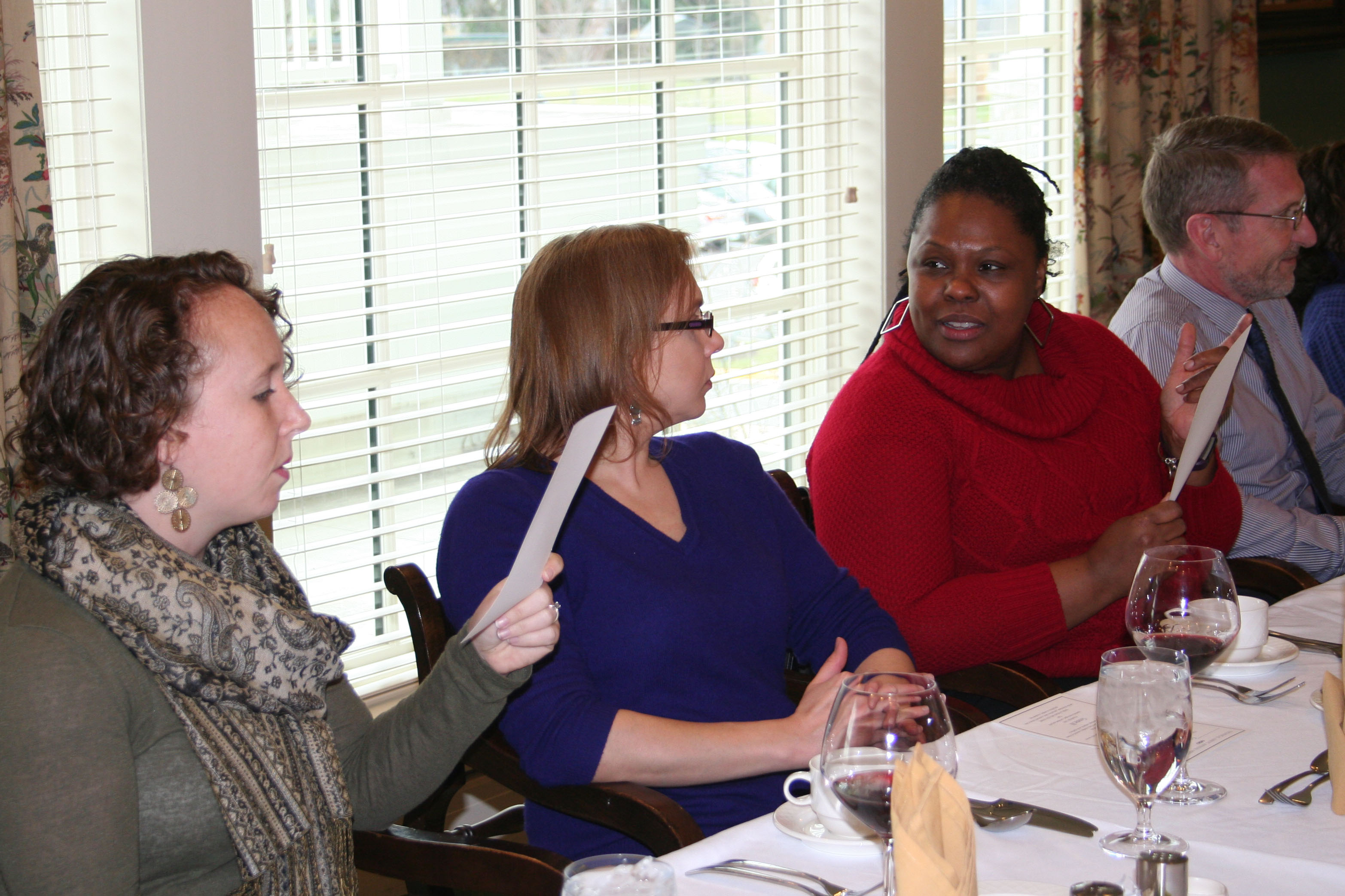 Technical Assent employees talk during a luncheon