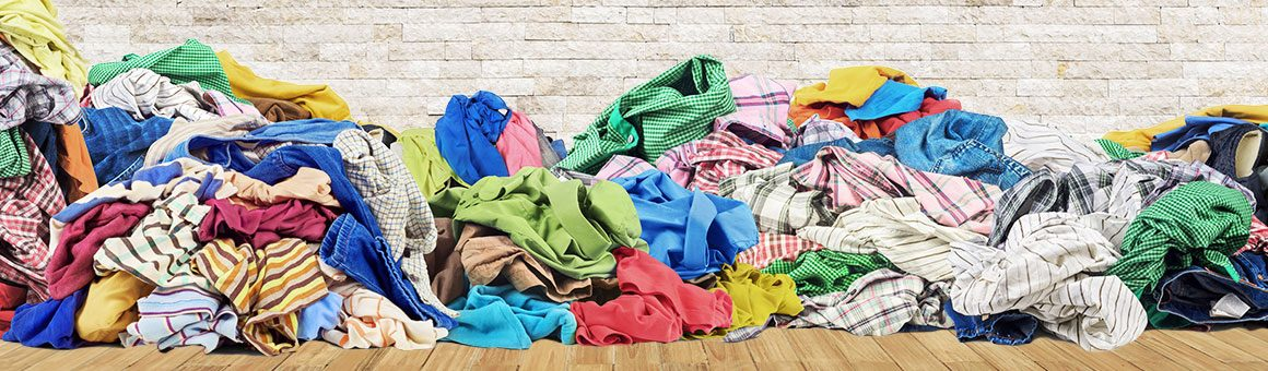 an untidy pile of clothes on the floor