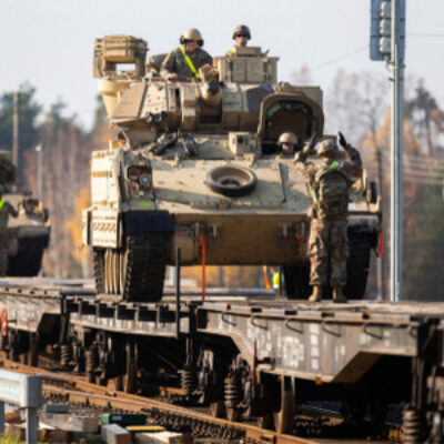 U.S. Army soldiers attend to the logistics of transporting equipment while deployed overseas