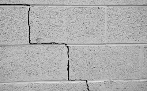 A crack in a building wall caused by an earthquake