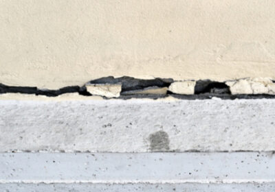 A crack in the foundation of a building